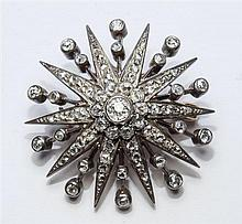 A Victorian gold, silver and diamond star pendant brooch the brooch set on a trembleuse mount,