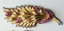 An 18ct gold, ruby and diamond foliate brooch 1950s, the leaves with a satin textured surface,
