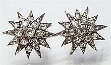 A pair of Victorian gold, silver and diamond star earrings the twelve pointed stars set with graduated old cut and rose cut diamonds,