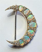 An 18ct gold, opal and diamond crescent moon brooch
