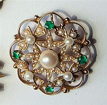 A 14ct gold, emerald and seed pearl brooch of floral openwork form,