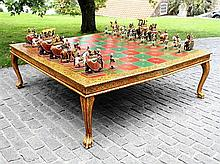 A large and impressive Indian carved wooden and polychrome painted chess set & table board mid-20th century,
