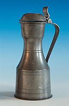 An English pewter tappit hen lidded measure early 19th century, of typical shouldered form with incised line decoration,