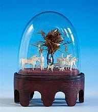 A charming Dieppe ivory hunting diorama of small proportions, the assembled group of carved Dieppe ivory horses,