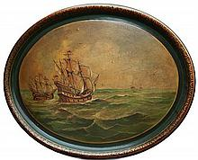A Victorian papier-mâché oval tray the lacquered tray decorated with a marine scene of two galleons sailing in a stiff breeze,