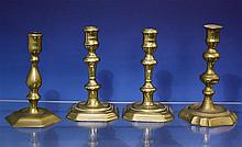 A pair of late 17th century English seamed brass candlesticks with waisted socket,
