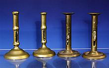 A pair of mid 18th century seamed brass ejector candlesticks the cylindrical stems of rolled and seamed sheet brass with ejector slots,