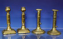 A pair of late 18th century seamed brass ejector candlesticks c.1770, the cylindrical seamed stems with line engraved collar and bands,