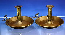 A pair of Victorian Boer War 'War Department' brass chambersticks in the mid-18th century style,