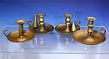 A pair of late 18th century brass chambersticks c.1800, with plain saucer dished bases, turned urn form nozzles,