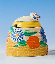 A Clarice Cliff Bizarre 'Canterbury Bells' pattern beehive honey pot c.1932, the moulded beehive form pot in honey glaze,