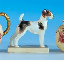 A Royal Worcester figure by Doris Lindner (1896-1979) of an alert looking Terrier standing on a rectangular plinth,