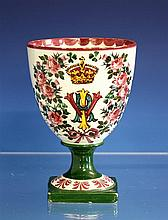 A Wemyss pottery commemorative goblet 1890s, commemorating Queen Victoria's Diamond Jubilee, of ovoid form on a square pedestal base,