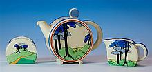 A Clarice Cliff Bonjour series three piece tea set in the rare Blue firs pattern, the teapot of circular form, C scroll handle,