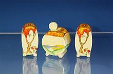 A Clarice Cliff 'Taormina' pattern three piece Bonjour cruet set c.1937, comprising salt and pepper castors and a lidded mustard,