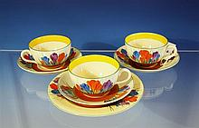 Three Clarice Cliff Bizarre 'Autumn Crocus' pattern tea cups and saucers c.1930, with black printed backstamps,
