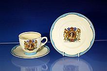 A Clarice Cliff 1953 Coronation trio comprising a tea cup, saucer and 6½in. tea plate,