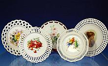 Five porcelain ribbon plates early 20th century, of various designs with parrots, floral, fruit and a ladies portrait,