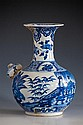 A Chinese blue and white kendi probably 18th century, the globular body rising from a short straight foot to a long,
