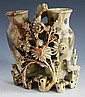 A Chinese carved soapstone double vase probably late Qing dynasty, in mottled celadon green, iron red and brown soapstone,