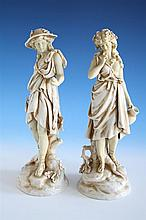 A pair of Rudolstadt ivory porcelain figures 1920s-30s, German, modelled as male and female classical figures,