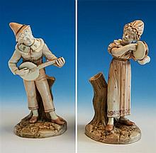 Two Royal Worcester figures circa 1887, by James Hadley, comprising a young girl playing a tambourine and a boy minstrel with banjo,
