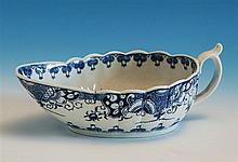 A first period Worcester sauce boat c.1780, of shallow fluted form, interior decorated with the 'Doughnut Tree' pattern,