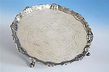 A George II silver salver Robert Abercromby, London 1741, with shell and scroll rim, on three hoof feet,