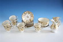An English porcelain part tea service early 19th century, decorated in gilt on a white ground with passion flowers, hearts and foliage,