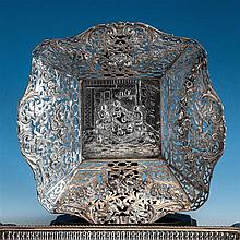 A Dutch pierced silver fruit basket c.1900, marks partially rubbed, of flared and shaped square form,
