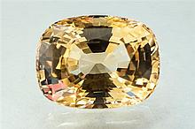An unmounted cushion cut pale yellow sapphire the fine quality stone weighing 7.55 carats.