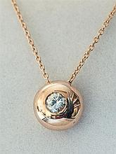 An 18ct gold rose gold and diamond pendant the domed circular pendant set with a single 0.20 carat round brilliant cut diamond,