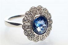 An 18ct white gold sapphire and diamond Art Deco style ring