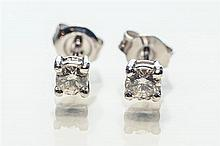 A pair of 18ct white gold and diamond stud earrings the round brilliant cut diamonds totalling 0.38 carats, in four claw settings. (2)