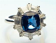 An 18ct white gold,, sapphire and diamond cluster ring
