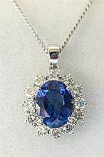 An 18ct white gold,, tanzanite and diamond pendant