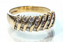 An 18ct yellow gold and diamond ring set with seven diagonal rows of three round brilliant cut diamonds, ring size Q.