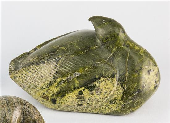 An inuit green stone carving by pudlo pudlat cap