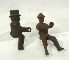 2 Antique CI Toy Wagon Figures