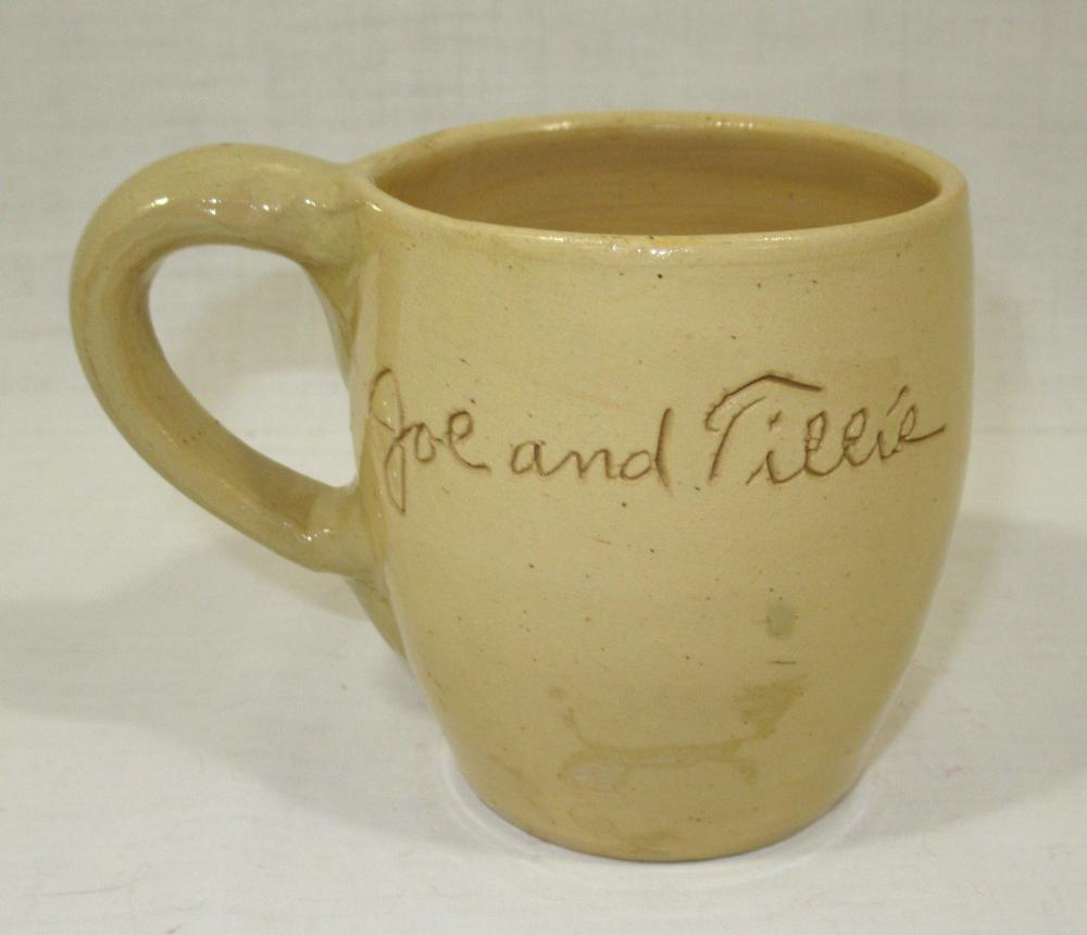 "Evans Pottery Scratch Cup ""Joe and Tillie"""