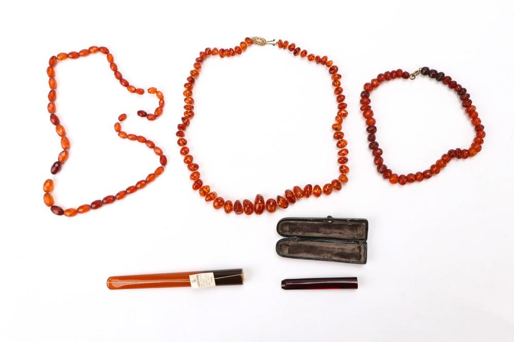 3 Baltic and Coptic Amber Necklaces and 2 Cigarette Holders