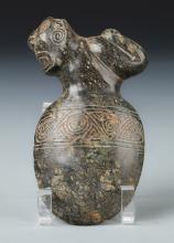 Taino Reclining Figure Atop an Ax Form (1000-1500 CE)