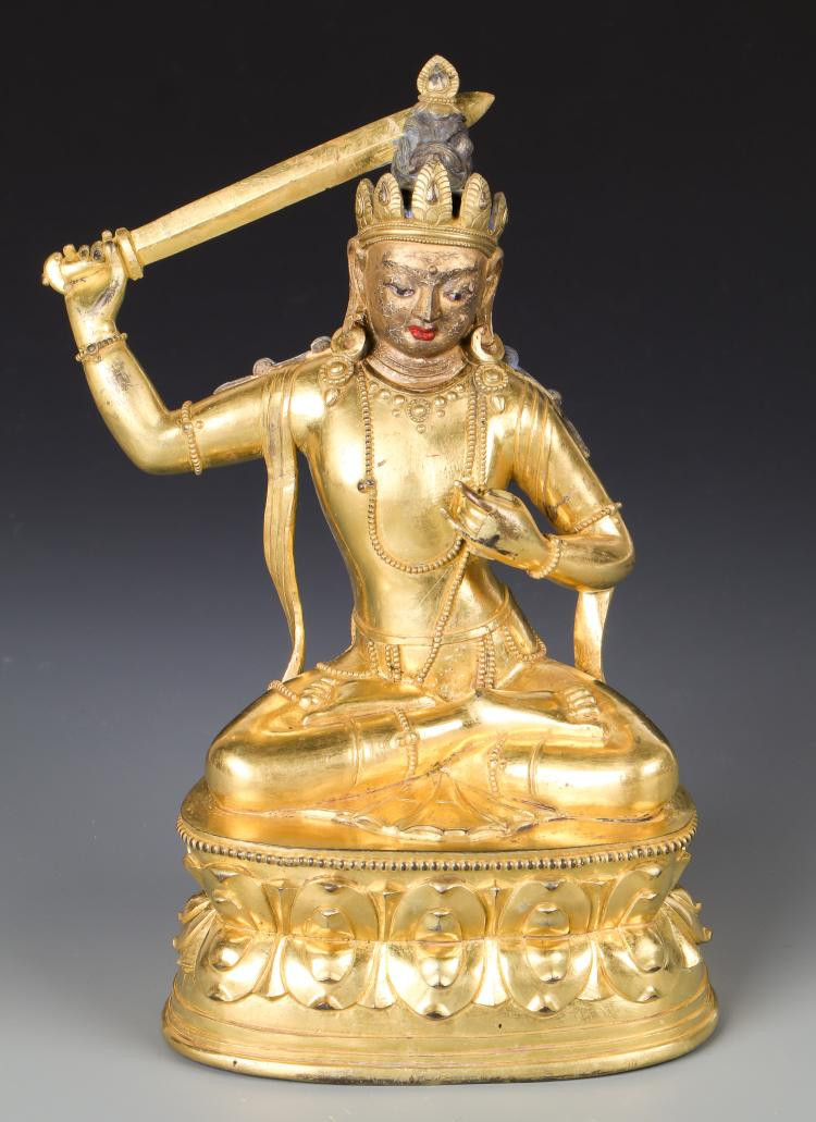 Antique Sino-Tibetan Gilt Bronze Buddha with Sword