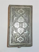 Persian cigarette box made of silver in Isfahan work, decorated with hand-engravings of flowers and a typical central medallion. A...