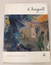 A hard-cover copy of Chagall by Werner Haftmann, published by Harry N. Abrams, Inc., New York, in 1972. The book contains forty-ni...