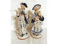 A pair of blue and white figurines