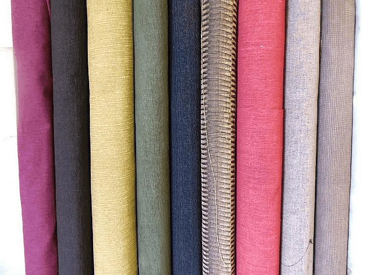 Ten rolls of upholstery fabric