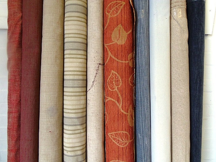 Assorted rolls of upholstery fabric