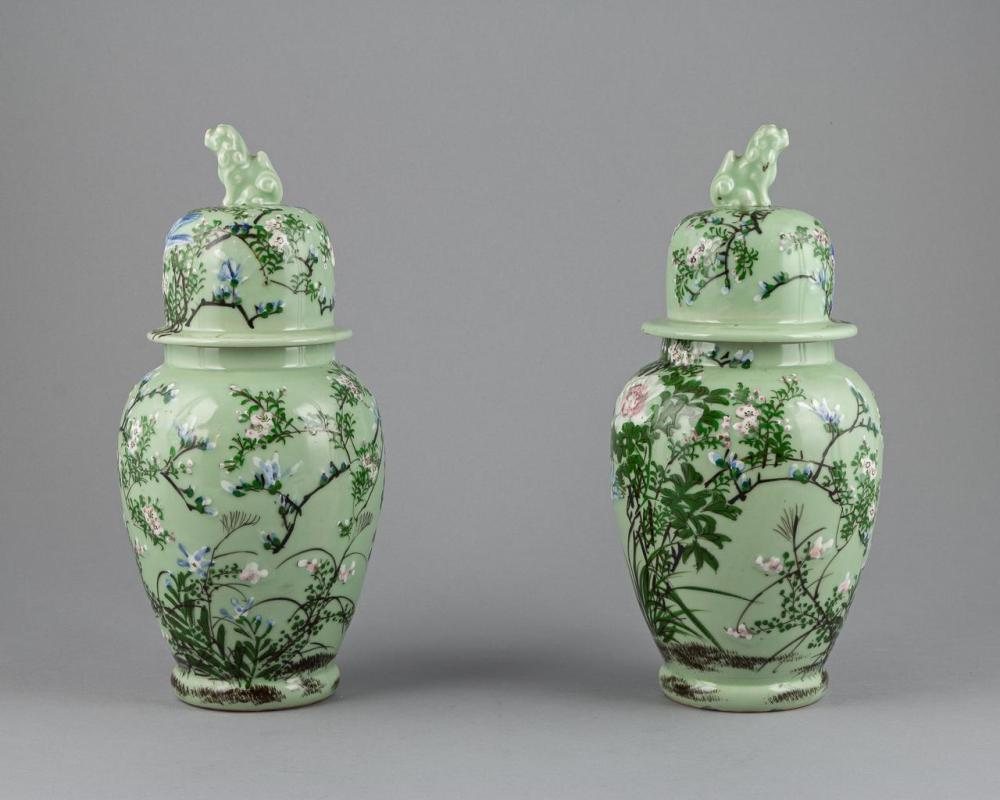 Lot - A pair of Japanese celadon glazed vases and covers ...