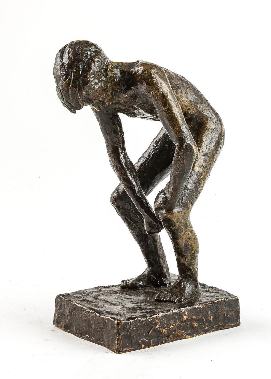 A 20th Century bronze sculpture of a reclining nude lady